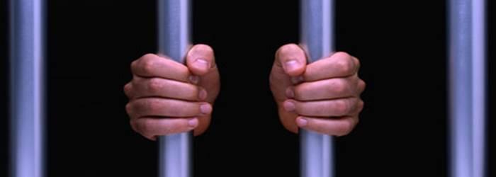 hands-on-prison-bars
